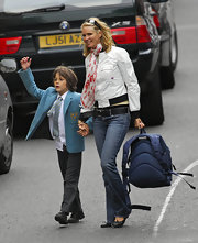 Elle Macpherson is no ordinary mum taking her kid to school: Here she shows her wicked side in a trendy skull-print scarf.
