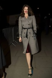Gemma Artertonshowed her classic style with a belted plaid trench coat while out after the Brit Awards.