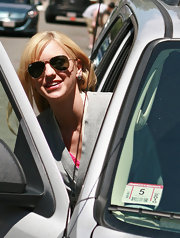 Anna wore a classic pair of gold Aviator Sunglasses with a casual ensemble.