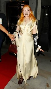 Vivienne Westwood wore a pale yellow silk cutout dress to the Fashion for Relief Olympic party.