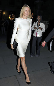 "This elegant black ""Kate"" bag perfectly complements Naomi's streamlined white dress."