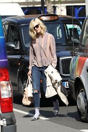 Fearne Cotton left Radio 1 in London wearing a pair of shiny metallic silver flats.