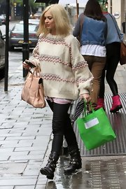 Fearne Cotton left Radio 1 Studios in London wearing a pair of black leather motorcycle boots.