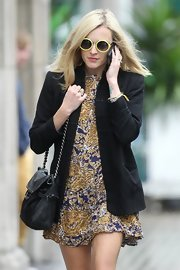 We love Fearne's silky print dress and funky shades she wore in London.