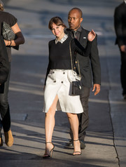 Felicity Jones flashed some leg in a high-slit white wraparound skirt.