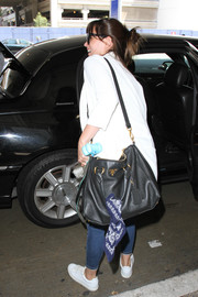 Felicity Jones' black Prada cross-body tote looked very stylish while being practical at the same time!
