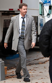 Will Ferrell trecked through downtown in a gray plaid blazer.