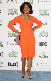 Angela Bassett looked ageless in a tight-fitting orange sheath during the Film Independent Spirit Awards.