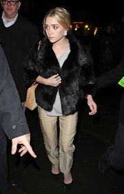 Ashley Olsen kept warm in a short black fur coat in New York City during Mercedes-Benz Fashion Week.
