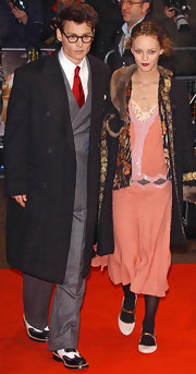 It's a rarity to see Johnny in a polished look. Here the clean shaven Depp wears a large wool black coat over his suit.
