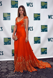 Devon attended the Wildlife Conservation Society's Spring Gala in a bright orange gown with embroidered detailing.