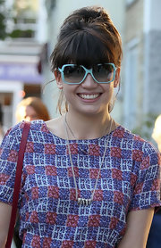 Daisy Lowe accessorized with a cute pair of blue square shades.