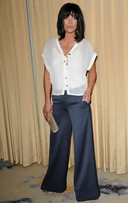 Jessica Szohr teamed a sheer white blouse with super wide-leg trousers that hid her shoes.