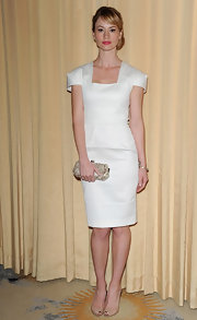 Cameron Richardson upped the elegance of her demure ivory dress with a glitzy hard case clutch.