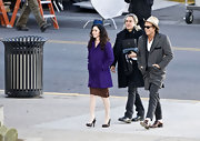 While shooting a scene for 'Passion Play,' Megan Fox is costumed in a fuzzy wool coat in an ultra bright shade of purple.