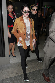 Frances Bean Cobain teamed her jacket with comfy black leggings.