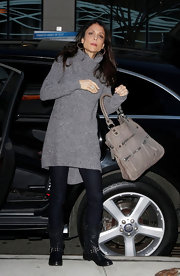Bethenny Frankel paired her street wear with a versatile taupe tote.