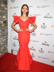 Eiza Gonzalez looked uber glam in a red mermaid gown with sculptural sleeves at the Fred Hollows Foundation fundraising gala.