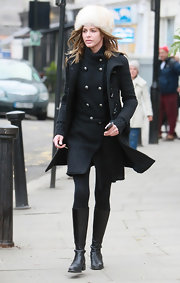 Trinny Woodall kept warm in black leather knee high boots.