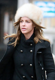 Trinny stays toasty in a cream fur hat and layers of coats while out in London.