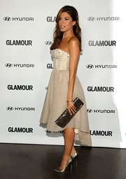 Eva Mendes dressed to impress in metallic platform pumps. The heels help toughen up an otherwise sweet dress.