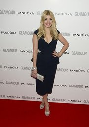 Holly Willoughby's red carpet look was a blend of classic and modern with this navy peplum dress with a deep V-neck.