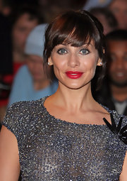 Natalie Imbruglia made her pout really pop with bright red lipstick.