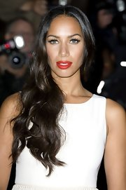 Looking ultra feminine, Leona Lewis attended the GQ Men of the Year Awards. With her lush, red lips, lengthy lashes and long, wavy hair she was the picture of glamour.