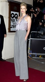 Charlize Theron shined in a lavender halter top at the GQ Men of the Year awards. She paired the look with gray trousers.