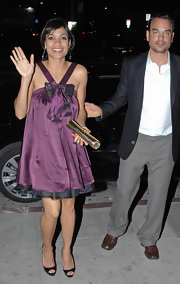 This gold python leather clutch worked well with Rosario's purple dress.