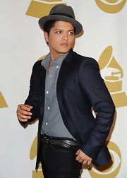 Bruno dons a pinstripe suit over jeans and with a fedora in this styling ensemble.