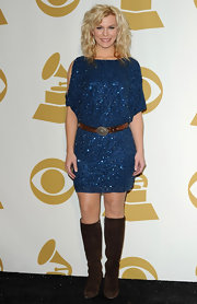 Kimberly Perry topped off her sparkling ensemble with brown suede knee-high boots.