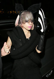 lady Gaga made her way through the cameras wearing a headband equipped with bunny ears and a lace veil from the Fall 2009 collection.