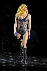 "Lady Gaga wears a sheer vinyl leopard print body suit over fishnets for her ""Monster Ball"" tour."