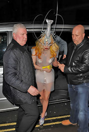 We don't know which part of Lady Gaga's look was more eye-catching--her sheer plastic short suit or her bedazzled lobster hat!