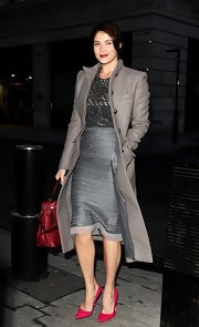 A silver knee-length skirt showed Gemma Arterton's classic and sophisticated style.