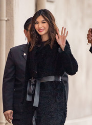 Gemma Chan headed to 'Kimmel' wearing a black teddy bear coat styled with a chic leather belt.