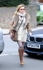 Geri Halliwell bundled up in a retro-inspired fur-lined jacket while stepping out in London.