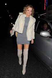 Geri brought on the sexy in this sweater dress and over-the-knee boots for 'Viva Forever' in London.