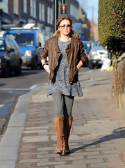 Geri Halliwell looked cool and casual while taking her daughter to school in this brown leather jacket.