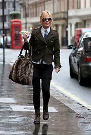 Geri goes for military chic in a green wool jacket with gold buttons.