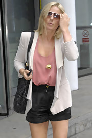 Geri Halliwell paired her tan blazer with black dress shorts and a simple tank top.