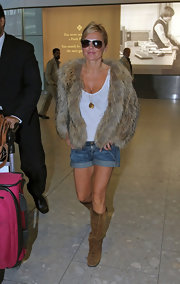 Geri looked ready for fall in a cozy fur coat and knee high suede boots.