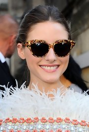 Olivia Palermo looked ultra-chic in a mosaic pair of cateye shades for the Giambattista Valli fashion show.
