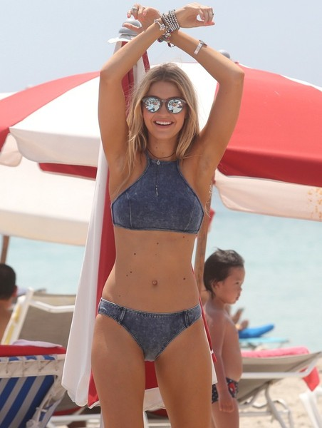 Gigi Hadid wore a cute denim-look halter bikini for a photoshoot in Miami Beach.