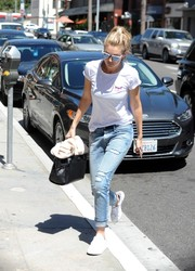 Gigi Hadid dressed down in a white tee by Current Moji for a day out in LA.