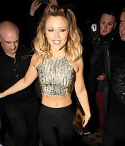 Kimberley Walsh showed off her curves in a gold crop top while out at Whisky Mist nightclub in London.