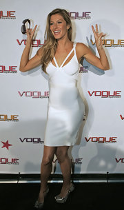 Gisele accessorized her sexy white frock with snakeskin platform pumps.