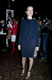 Natalia Vodianova layered a cropped navy blazer over her sleek sheath dress.