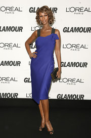 Iman was gorgeous on the red carpet in a draped cobalt blue cocktail dress. She paired the look with classic peep-toe pumps.